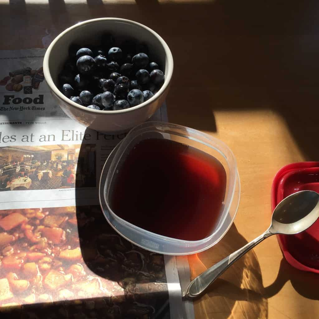 Afternoon snack, poached quince sauce on blueberries.