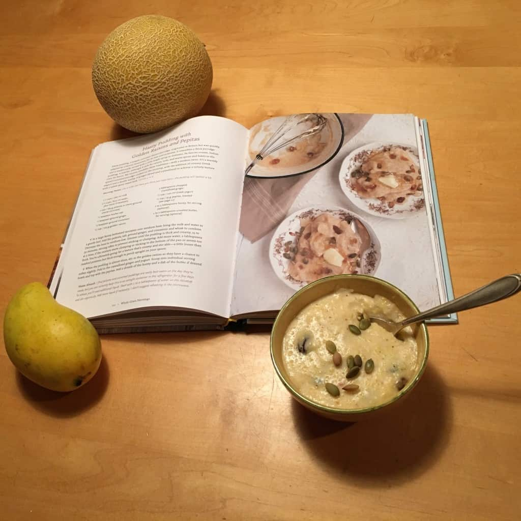 Hasty pudding with yellow raisins and pepitas in a bowl, for breakfast.