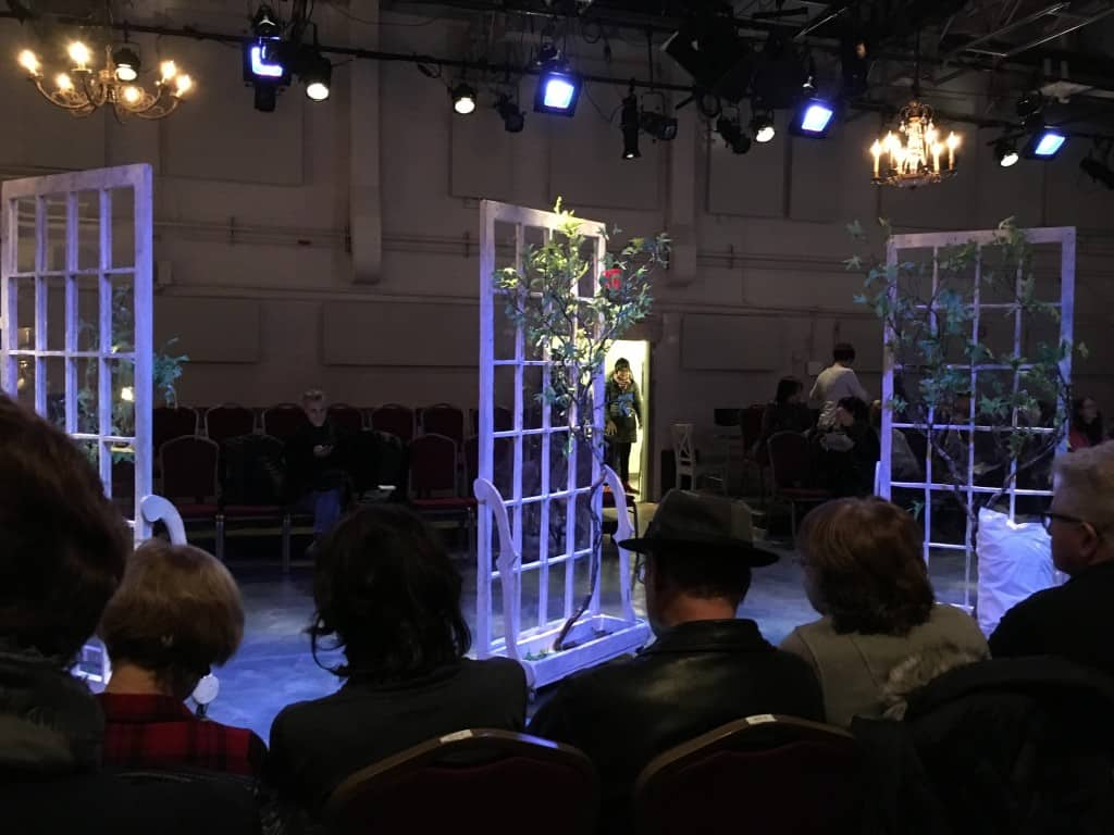 Inside the theater, trellis and trees.