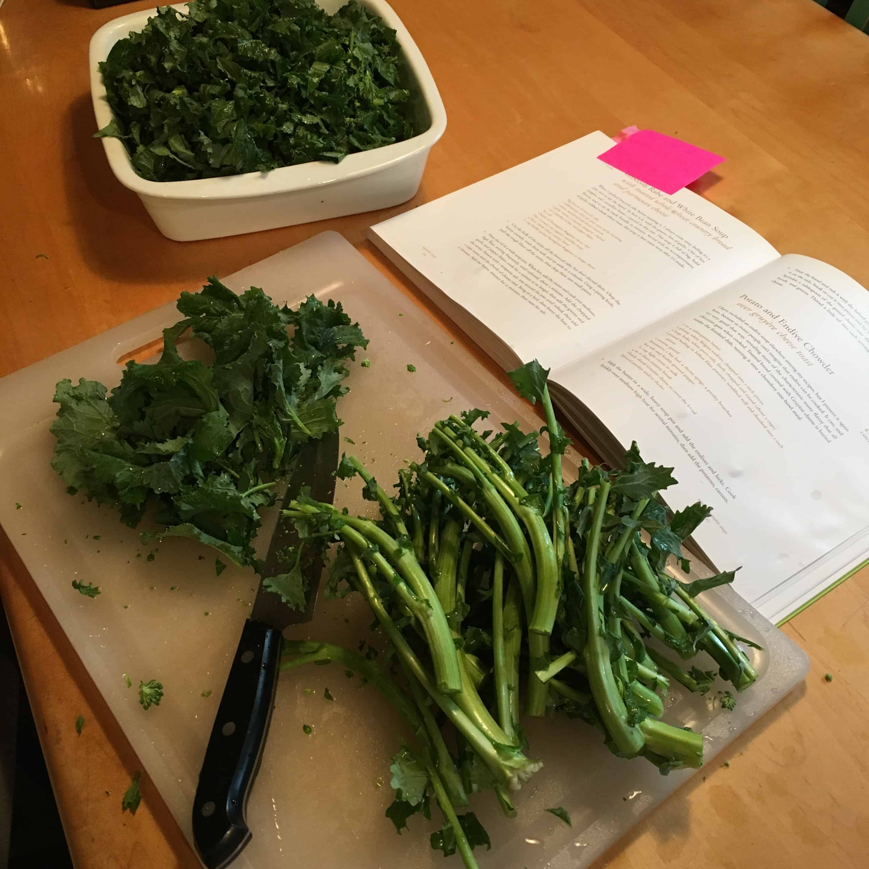 Trimming the broccoli rabe and pealing the tough stems.