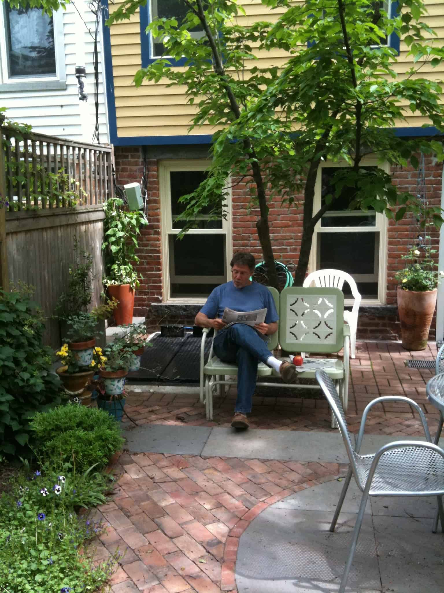 My favorite photo of Dan on glider in our garden.