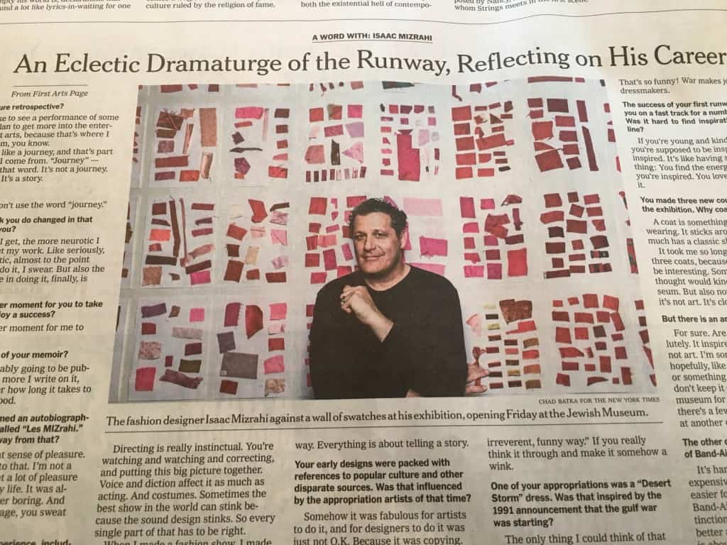 The fashion designer Isaac Mizrahi against a wall of swatches at his exhibition, opening Friday at the Jewish Museum. Credit Chad Batka for The New York Times
