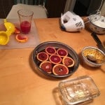 Juicing the blood oranges.