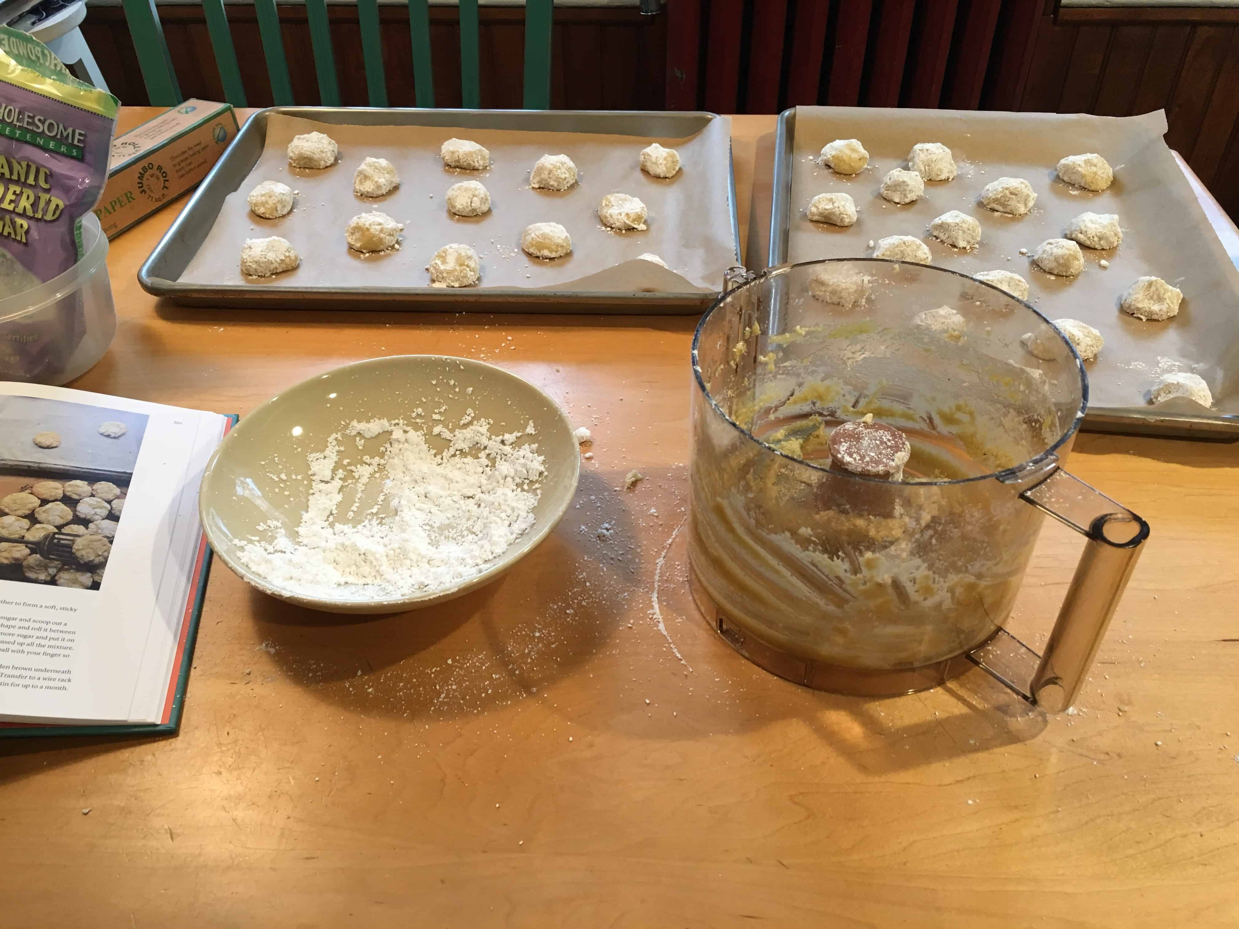 Mounds of almond cookies coated in confectioners' sugar.