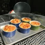Dramatic, puffy cheese soufflés , with gilded caps.