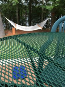 Flipflops under table, and hammock.