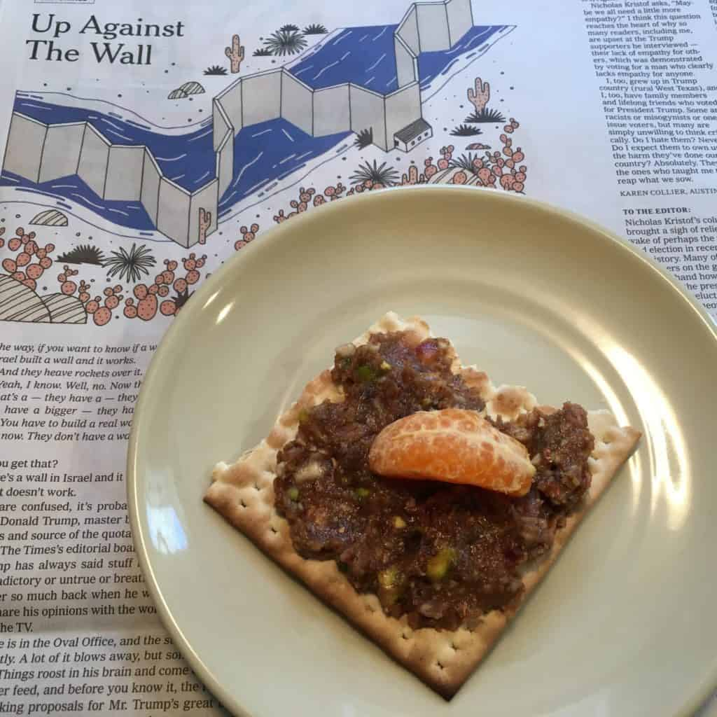 Charoset on matzo with your morning paper, a practice run for the the coming Passover seders.