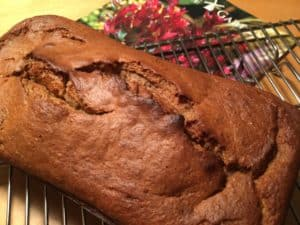 Cooling the banana bread on a rack.