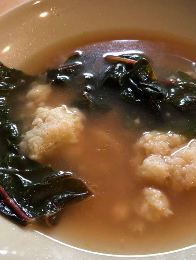 Parsnip dumplings in broth, and spruced up with chard.