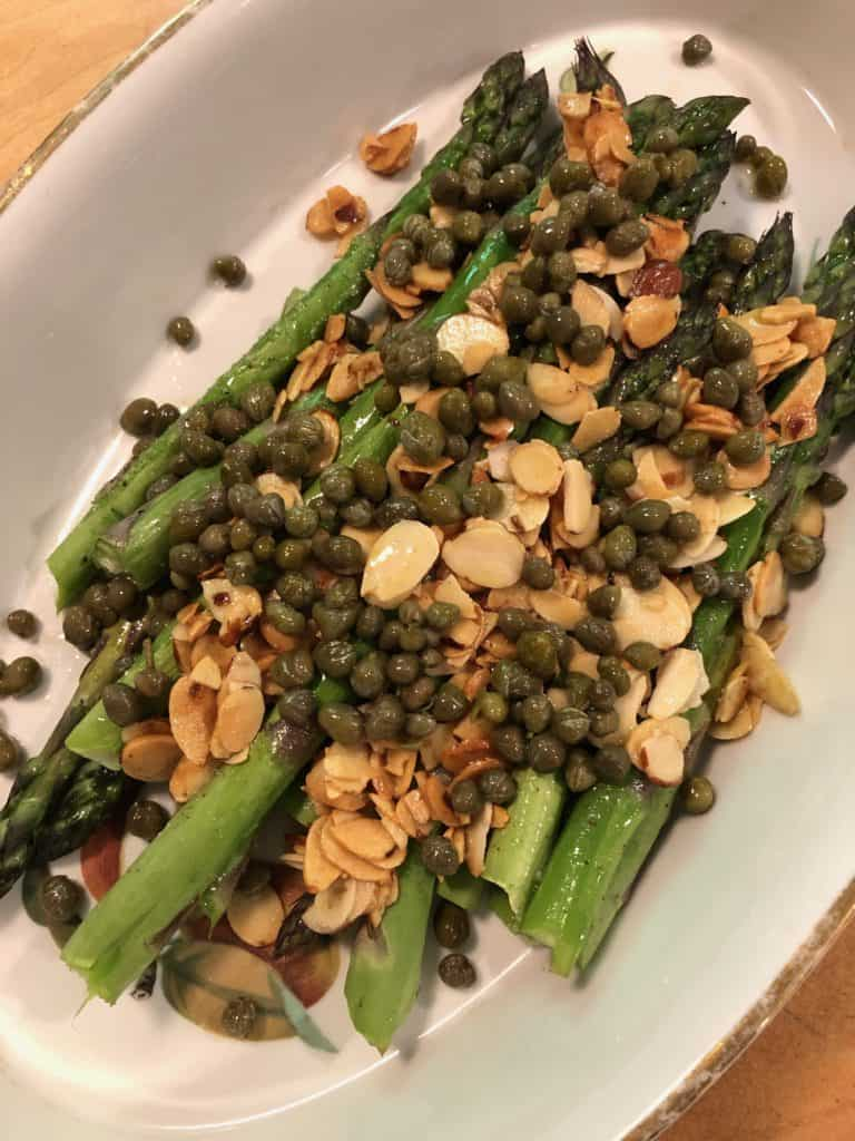 The crunch and the almonds and brine of the capers make this roasted asparagus with almonds capers, and dill, a delicious change to just roasted asparagus.