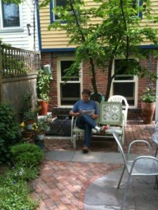 """My kitchen windows look out upon our garden. I love to look outside as I cook. This is my favorite photo of my husband Dan. Always reminds me of the Crosby Stills Nash lines, """"our house is a very very very fine house...."""""""