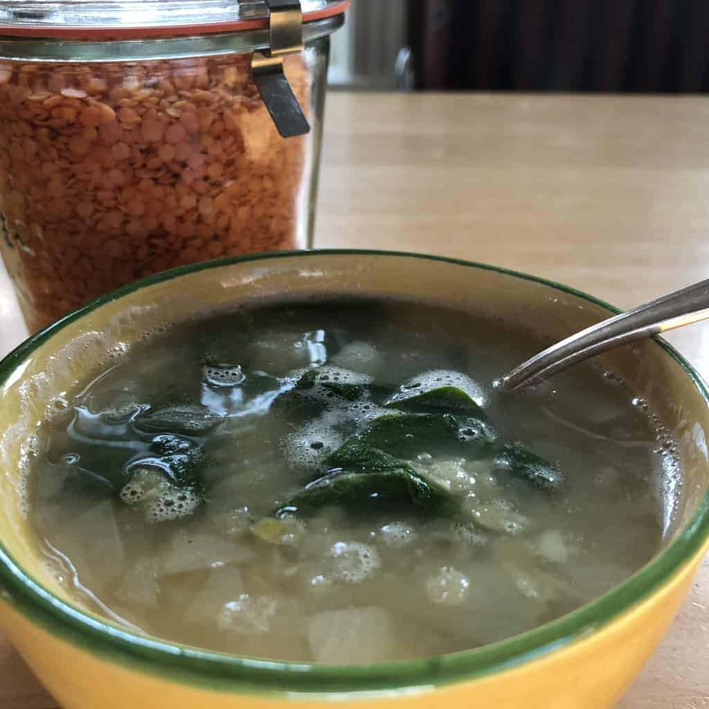 Red lentil soup with spinach, lemon, and pepper